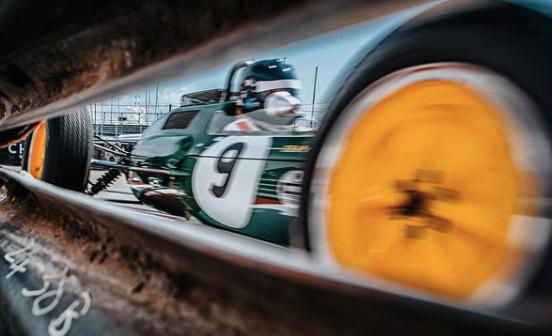 race car photographed between barrier